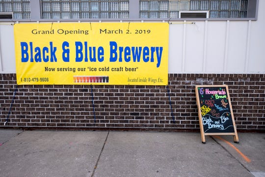 Black and Blue Brewery opened inside Wings Etc. on Quay Street in downtown Port Huron roughly a year ago. Now, the owner is hoping new signage for both the brewery and Wings will better entice visitors to their business and to Quay Street.