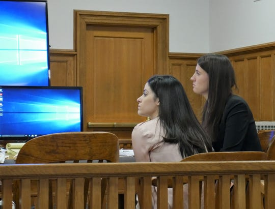 Nicole Addimando (pink shirt) sits in Dutchess County Court on April 4, 2019 with a member of her defense team, attorney Elizabeth Hood.