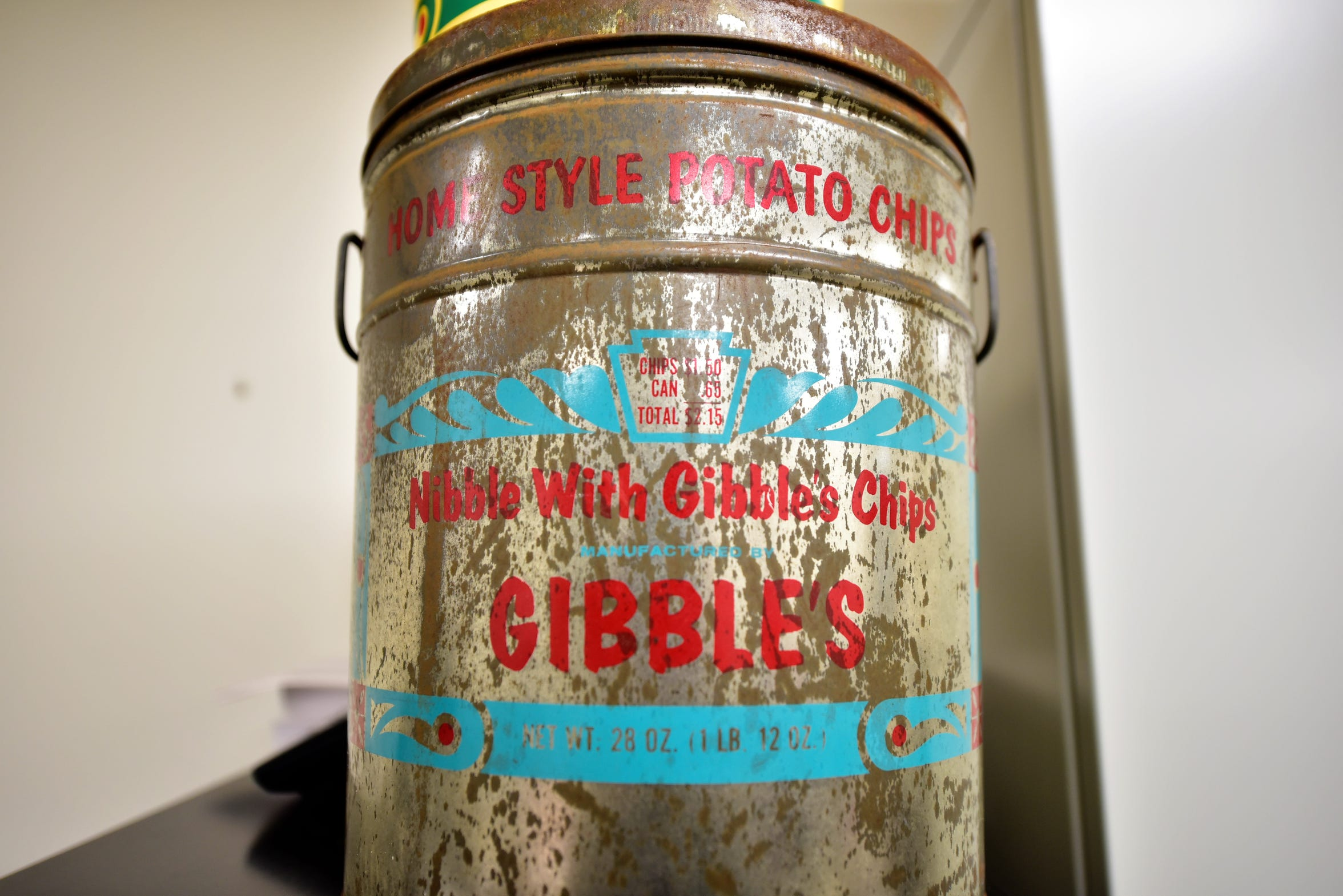 An old 28 oz. can of Nibble with Gibble's homestyle potato chips in an office at the Gibble's plant in Chambersburg. Notice the price: $1.50 for the chips, 65 cents for the can, for a total of $2.15. In 2019, an 8 oz. bag goes for $3.99.