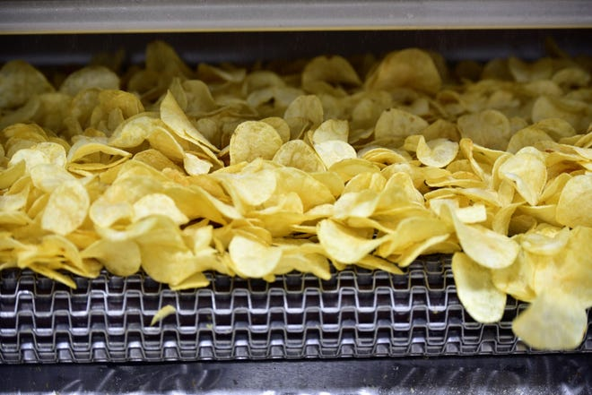 Warm, fresh potato chips head toward the last steps of the production process on March 20, 2019, at the Gibble's production facility, 6647 Molly Pitcher Highway, Chambersburg.