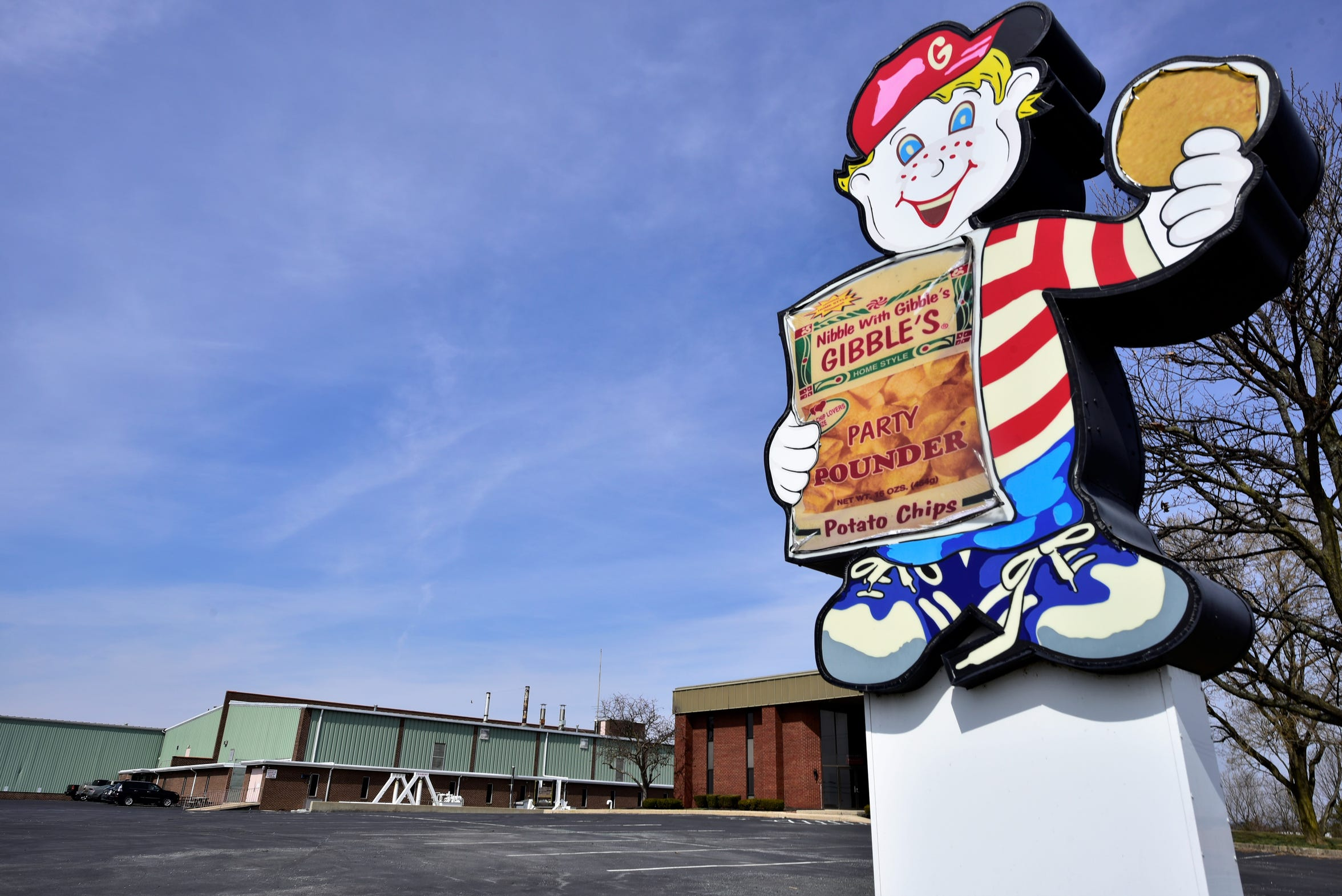 """""""Gilbert Gibble"""" offers a chip at the entrance to the Gibble's plant, 6647 Molly Pitcher Highway, Chambersburg. Pictured on March 20, 2019."""