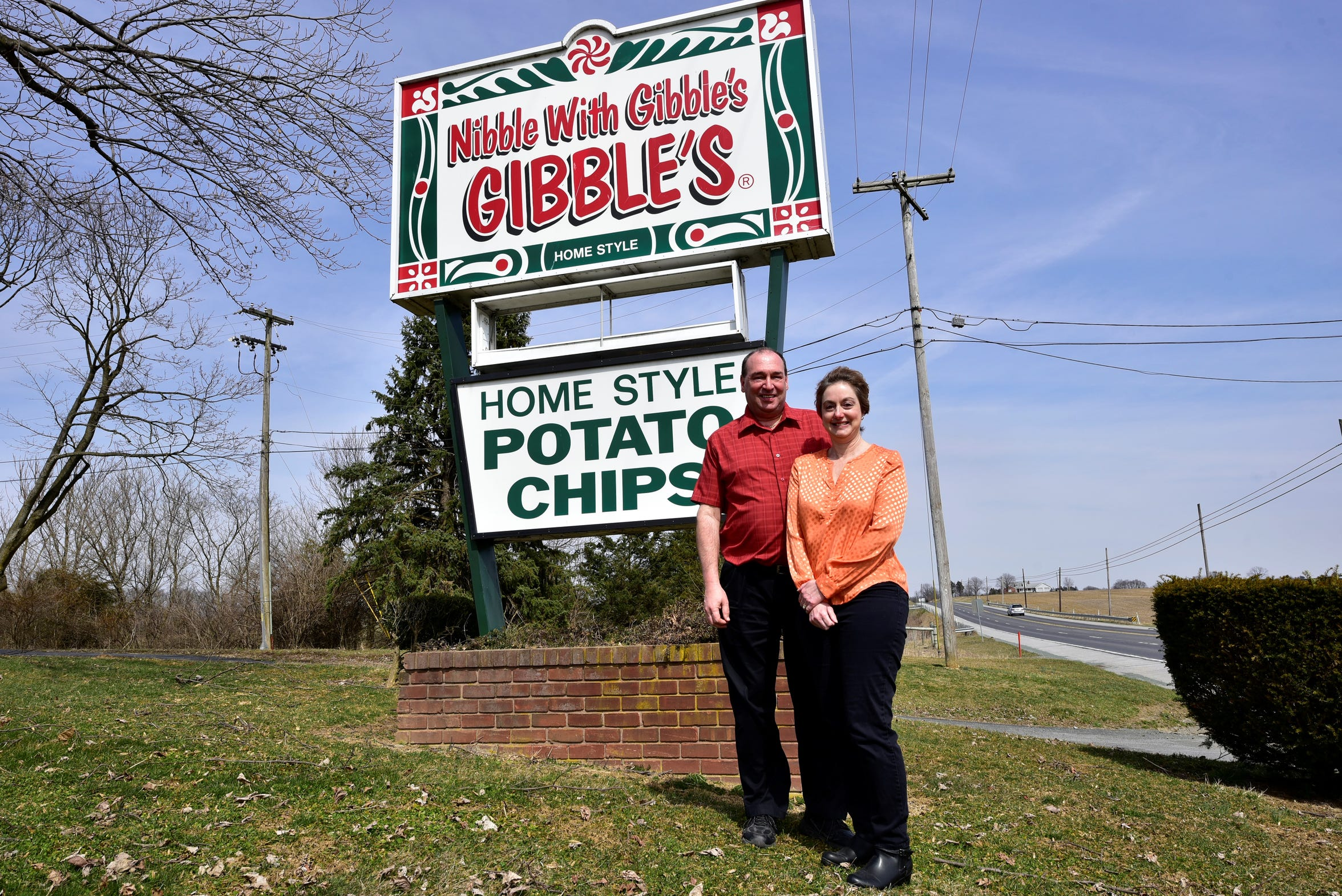 Robert and Amy Hartman pose for a photo in front of the Gibble's sign at the front of the company's property at 6647 Molly Pitcher Highway, Chambersburg.