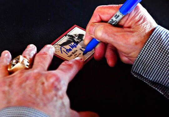 Former Baltimore Colt Tom Matte, autographs memorabilia during the 2019 York Area Sports Night show. In recent years, the program has basically become an autograph show and meet-and-greet event. Dawn J. Sagert photo