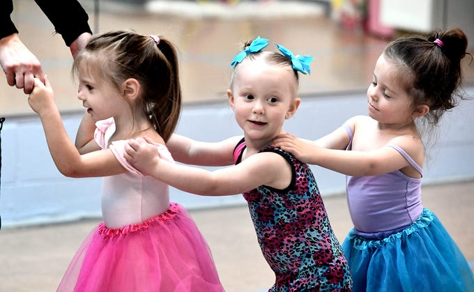 Children, from left, Aundrea Baughman, 3, of Dallastown; Alaina Byrne, 2, of West York; and Gracie Higgins, 2, of York Haven, form a train during the Twinkle Babies class at Greater York Dance on Thursday, April 4, 2019. The four-week program, for children ages 2 to 4, is part of the Twinkle Star Dance Program for early childhood dancers. Bill Kalina photo