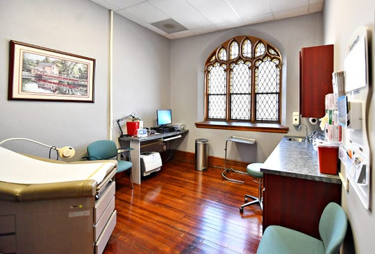 Exam Room 1, dedicated to Dr. Ann Ramage, A WellSpan doctor who died last year, at Katallasso Family Health Center in York City, Wednesday, April 3, 2019. Dawn J. Sagert photo