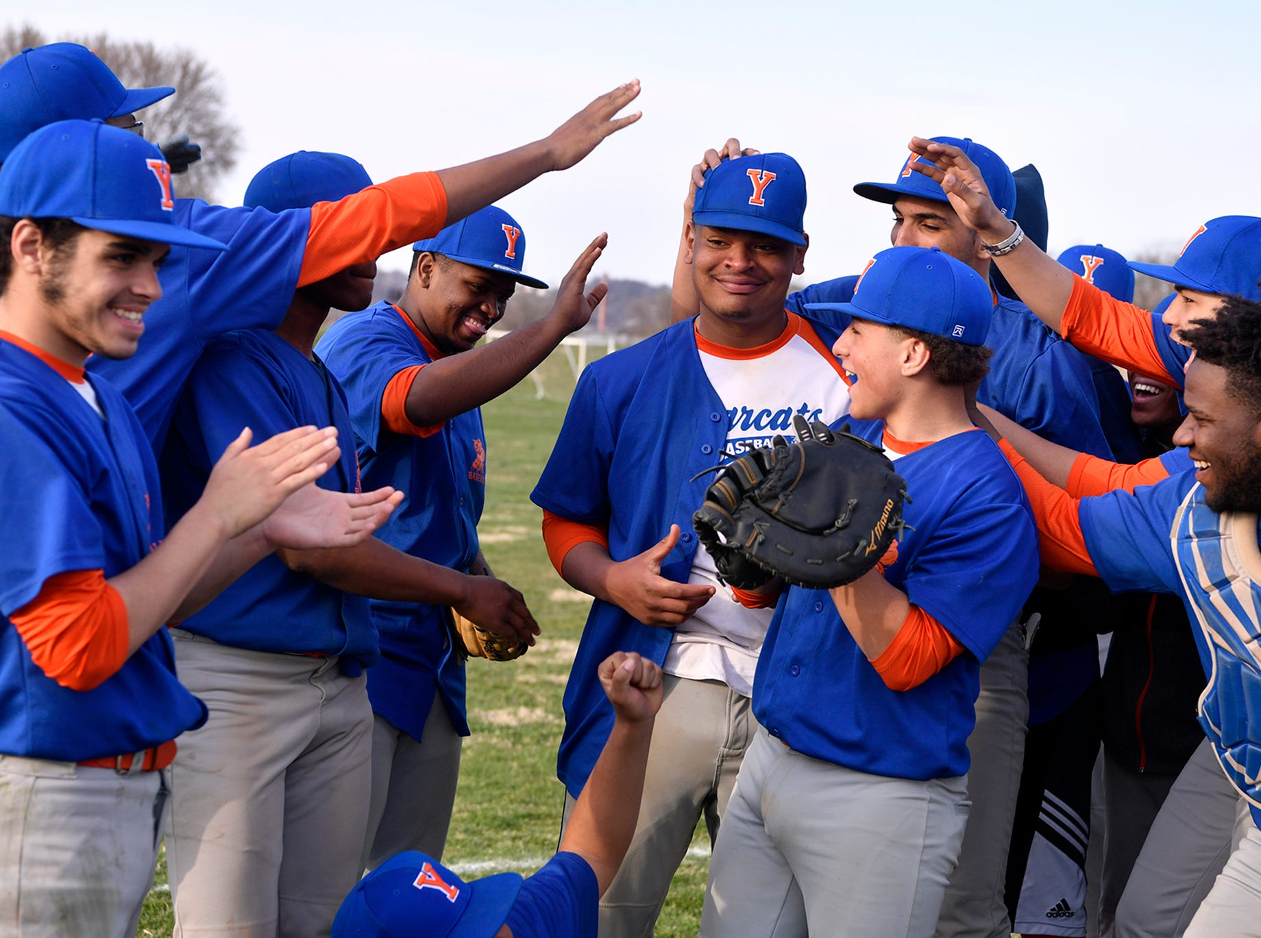 The Bearcats congratulates pitcher Joseph Garabito Torres after he was presented with the game ball after York High defeated Hanover, Thursday, April 4, 2019. This was the Bearcats first baseball win since 2012. John A. Pavoncello photo