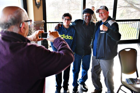 Boxer Pernell Whitaker, center, poses with fans at the 2019 York Area Sports Night program. Dawn J. Sagert photo