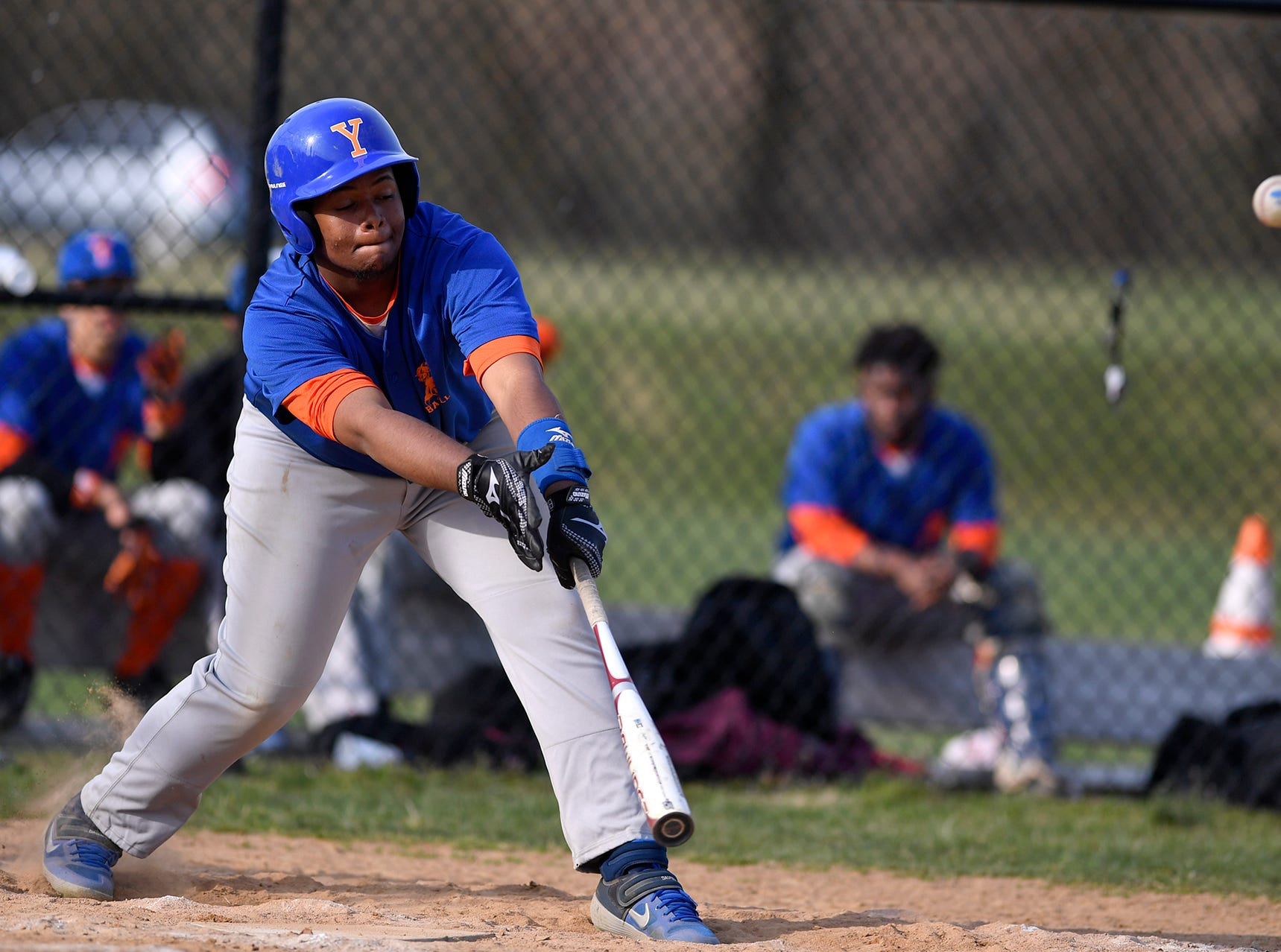 York High's Carlos Angeles Tejeda connects with an RBI single against Hanover, Thursday, April 4, 2019. John A. Pavoncello photo