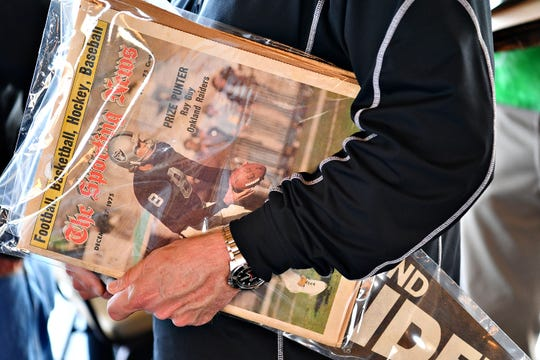 A fan walks away with some signed memorabilia during the 2019 York Area Sports Night show. Dawn Sagert photo.
