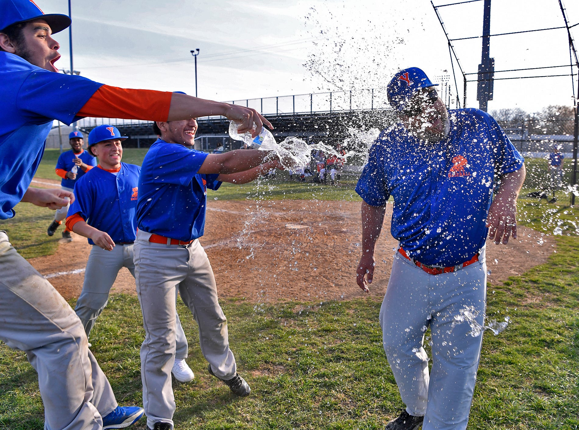 The Bearcats douse coach Dave Carr with water after winning their first game of the season, and the first since 2012, with a 8-4 win over Hanover, Thursday, April 4, 2019. John A. Pavoncello photo