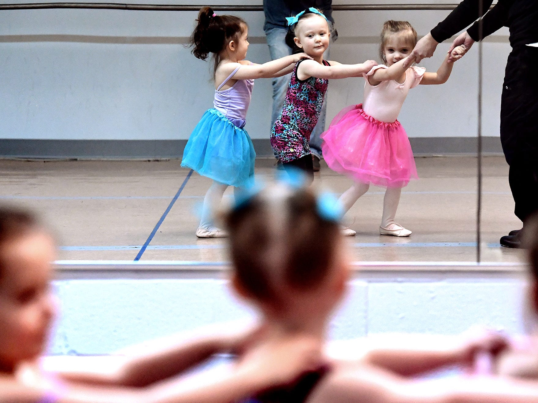 Children, from left, Gracie Higgins, 2, of York Haven; Alanina Byrne, 2, of West York, and Aundrea Baughman, 3, of Dallastown, form a train during the Twinkle Babies class with instructor Niki Zengerly at Greater York Dance Thursday, April 4, 2019. The four-week program, for children aged 2 to 4, is part of the Twinkle Star Dance Program for early childhood dancers. Bill Kalina photo