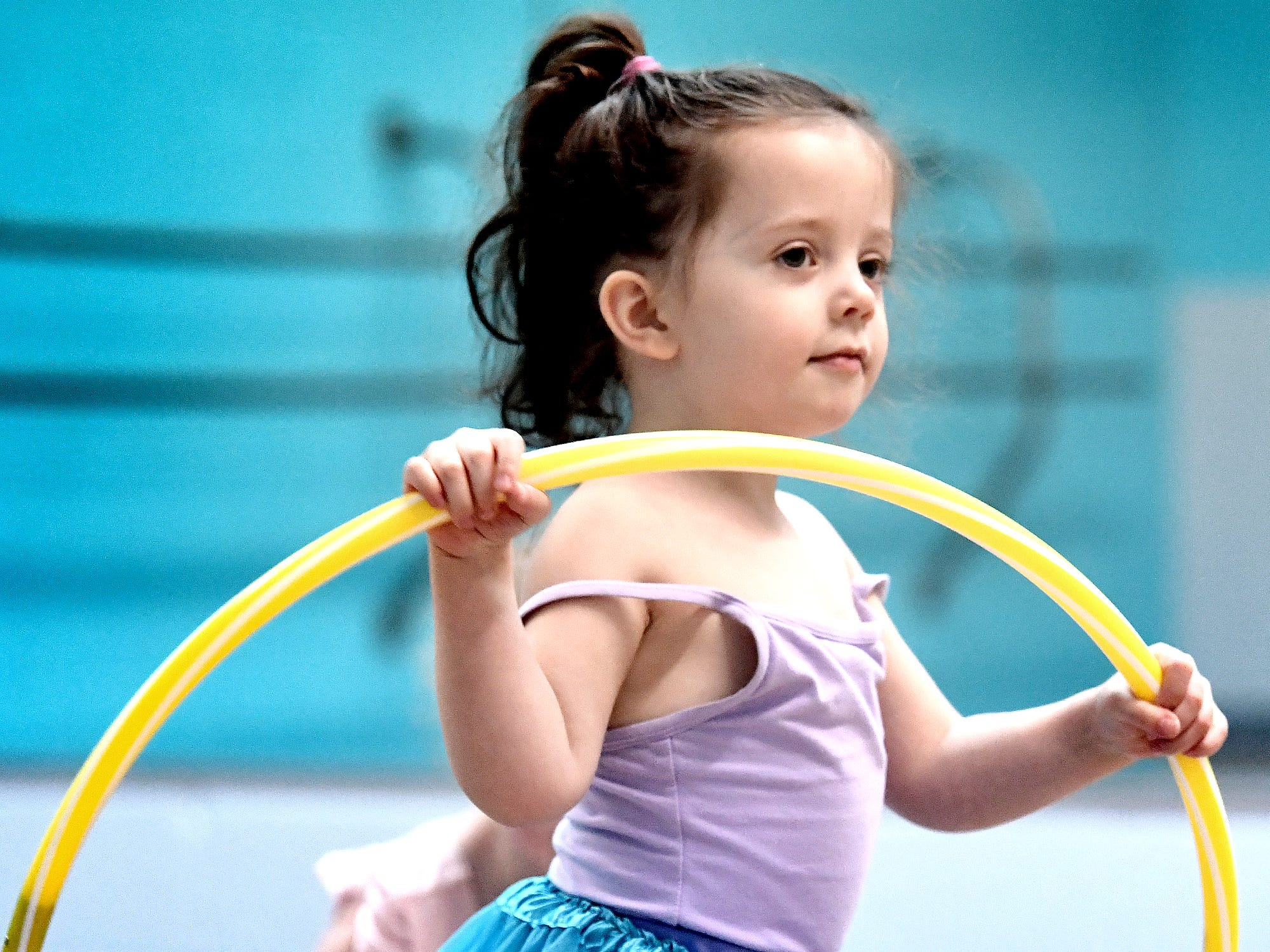 Gracie Higgins, 2, of York Haven, dances with a hula hoop during the Twinkle Babies class at Greater York Dance Thursday, April 4, 2019. The four-week program, for children aged 2 to 4, is part of the Twinkle Star Dance Program for early childhood dancers. Bill Kalina photo