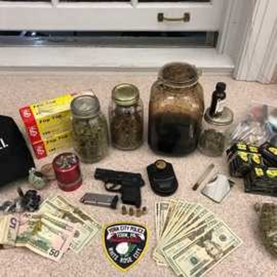 Police seized drugs, guns, and cash during a probation visit as a result of a shooting on Sunday, March 24, according to police.  Photo courtesy of York City Police.