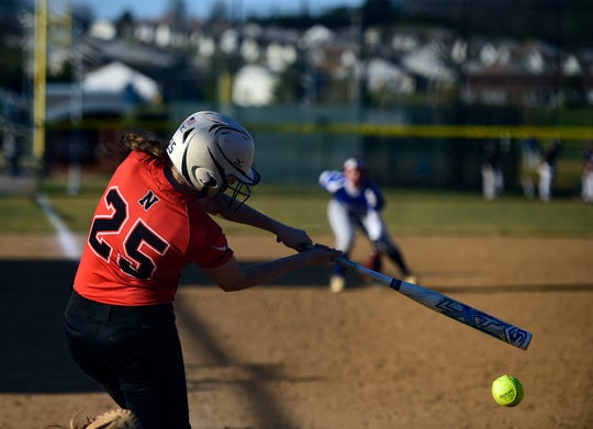 Northeastern Haley Updegraff swings over a pitch Wednesday, April 3, 2019.