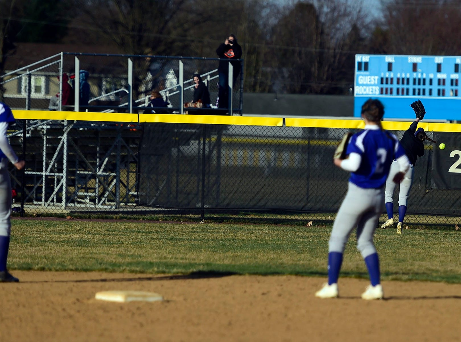 Spring Grove center fielder Bailey Rapson can't run down a hit to the center field fence Wednesday, April 3, 2019. Spring Grove defeated Northeastern, 19-14, in a game that featured 10 extra-base hits.