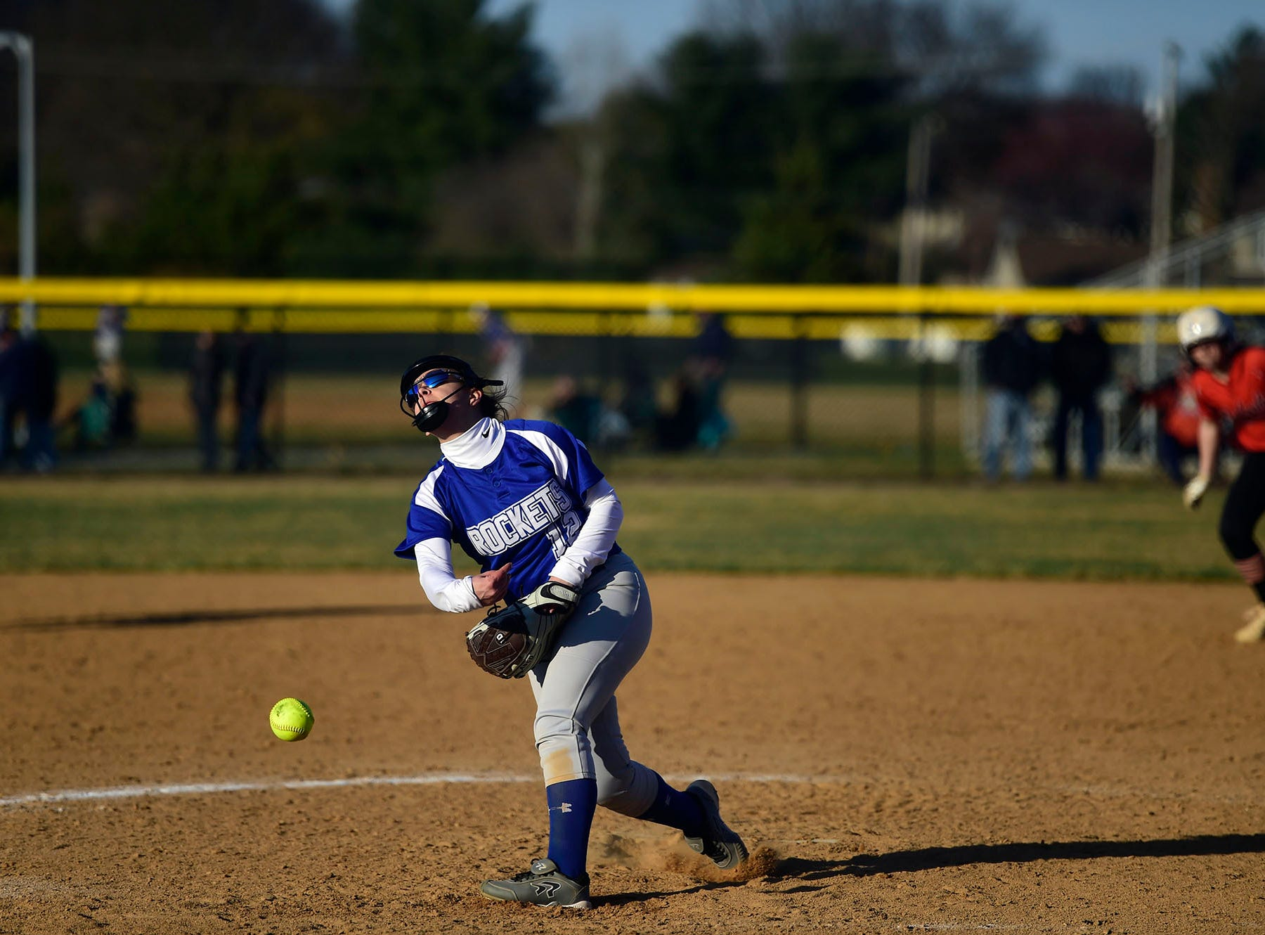 Spring Grove relief pitcher Sara Jones delivers to the plate with a runner on second base Wednesday, April 3, 2019.