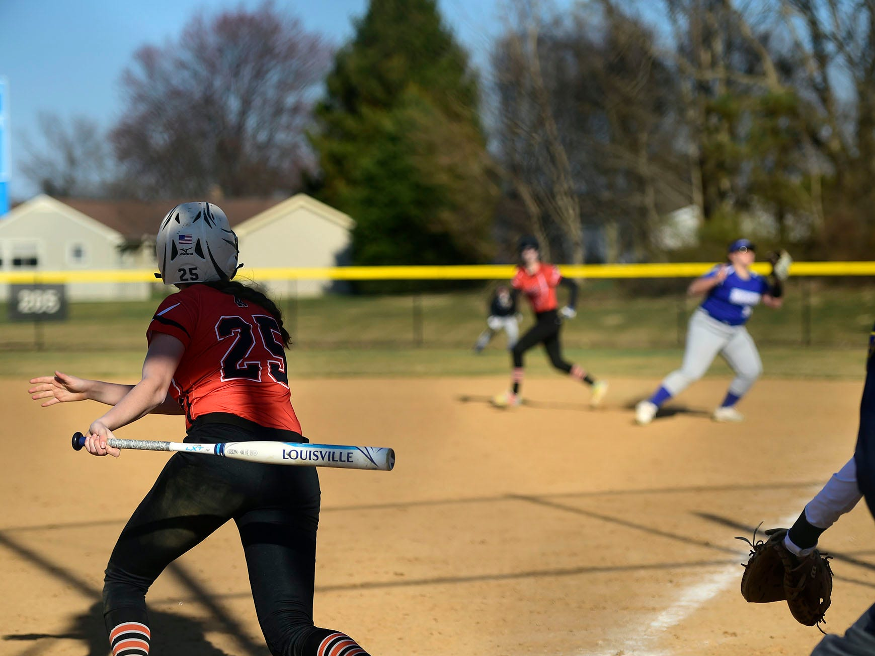 Northeastern leadoff hitter Haley Updegraff drives the ball down the first base line against Spring Grove Wednesday, April 3, 2019. Updegraff went 3-for-5 with four runs scored in a game Spring Grove won, 19-4.