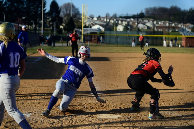 Spring Grove's Kristen Moore slides home to score a run during Spring Grove's 19-14 victory against Northeastern Wednesday, April 3, 2019.