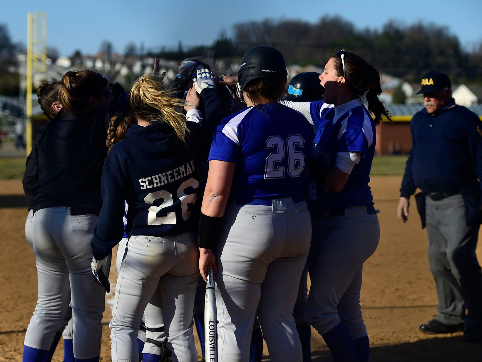 Spring Grove celebrate a home run hit by Hannah Gartrell. It was one of three homers hit by the Rockets Wednesday, April 3, 2019.