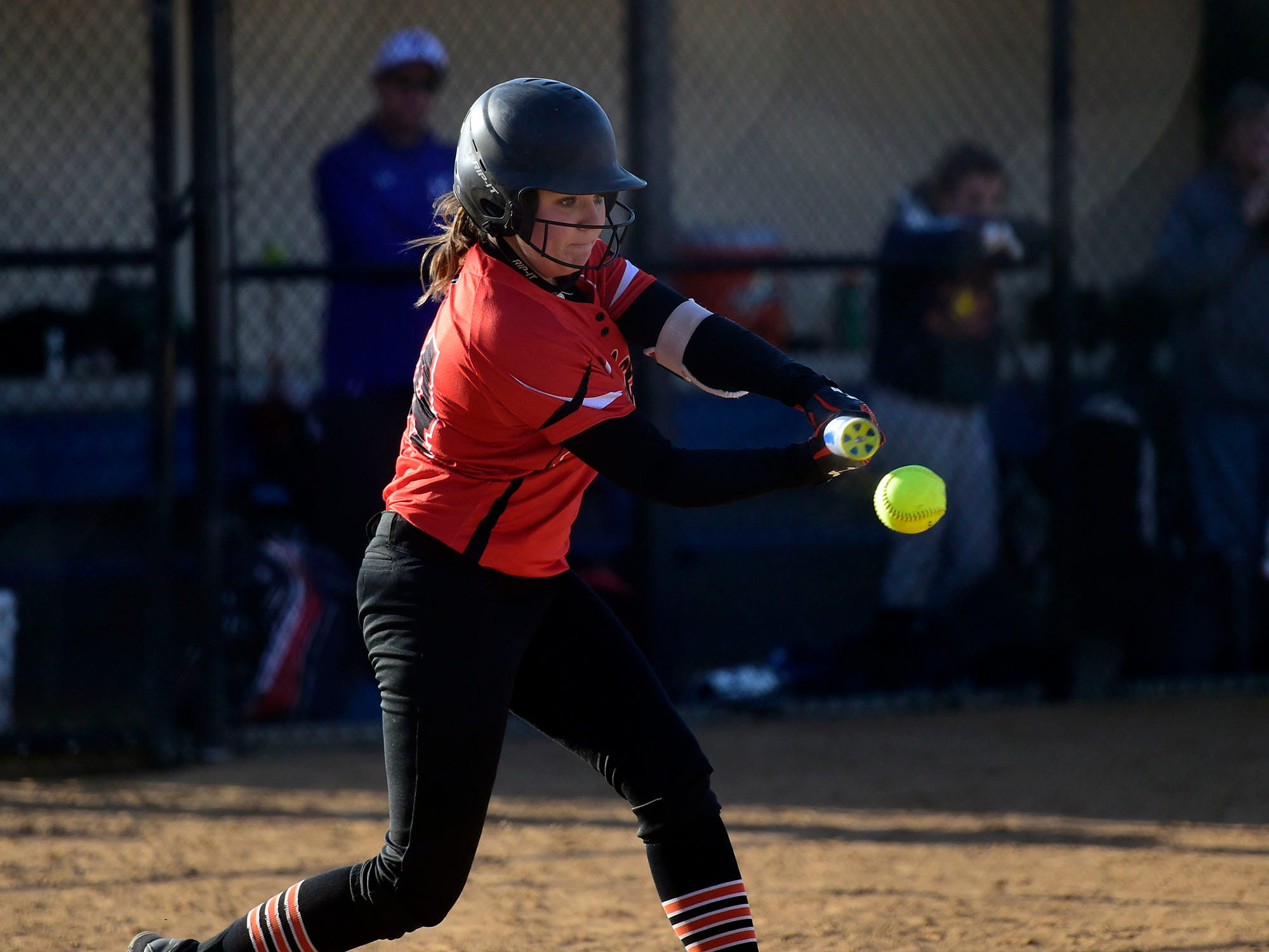 Northeastern's Megan Sweitzer swings at a pitch Wednesday, April 3, 2019.