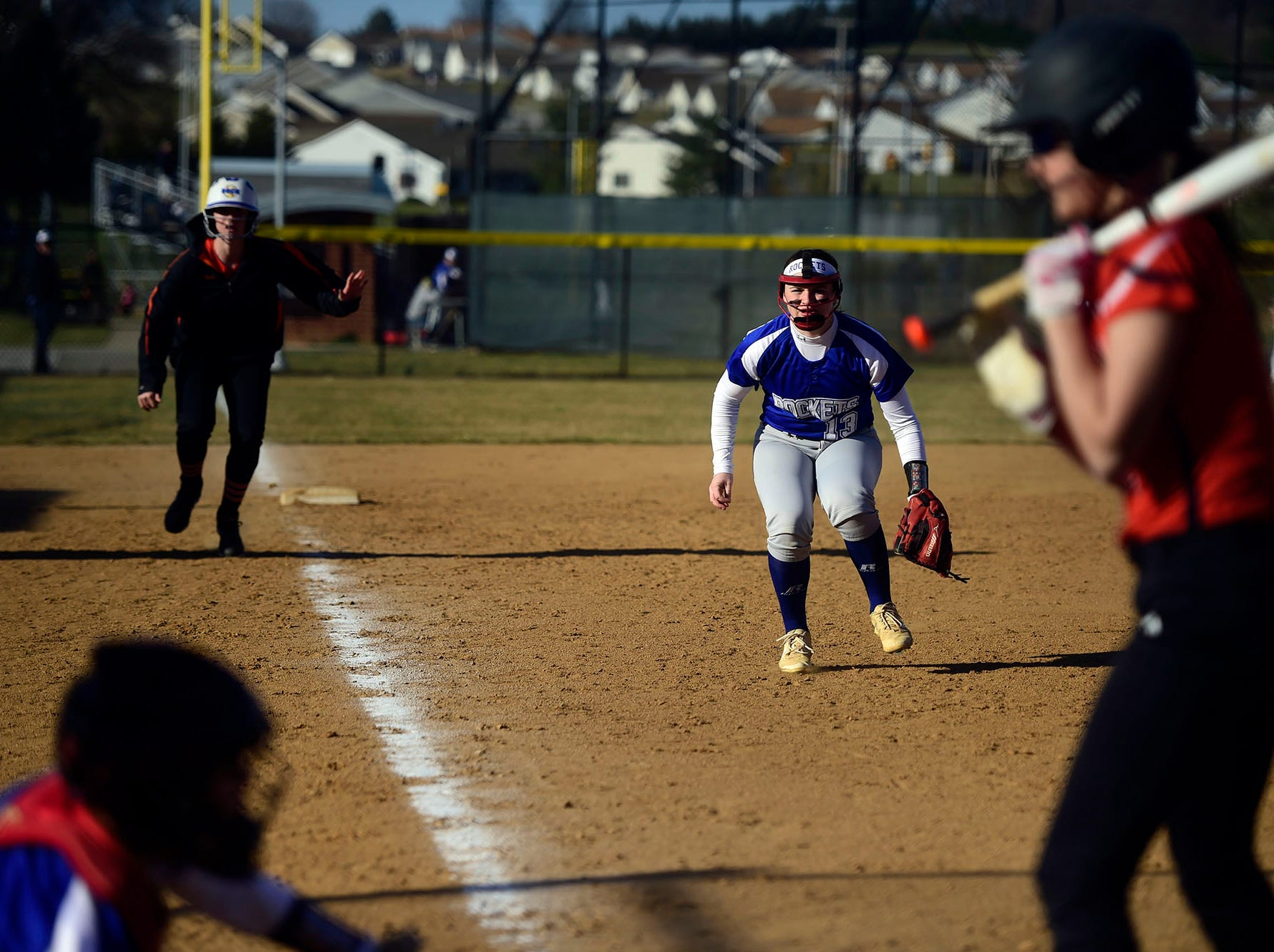 Spring Grove third baseman Hannah Gartrell charges the plate Wednesday, April 3, 2019.