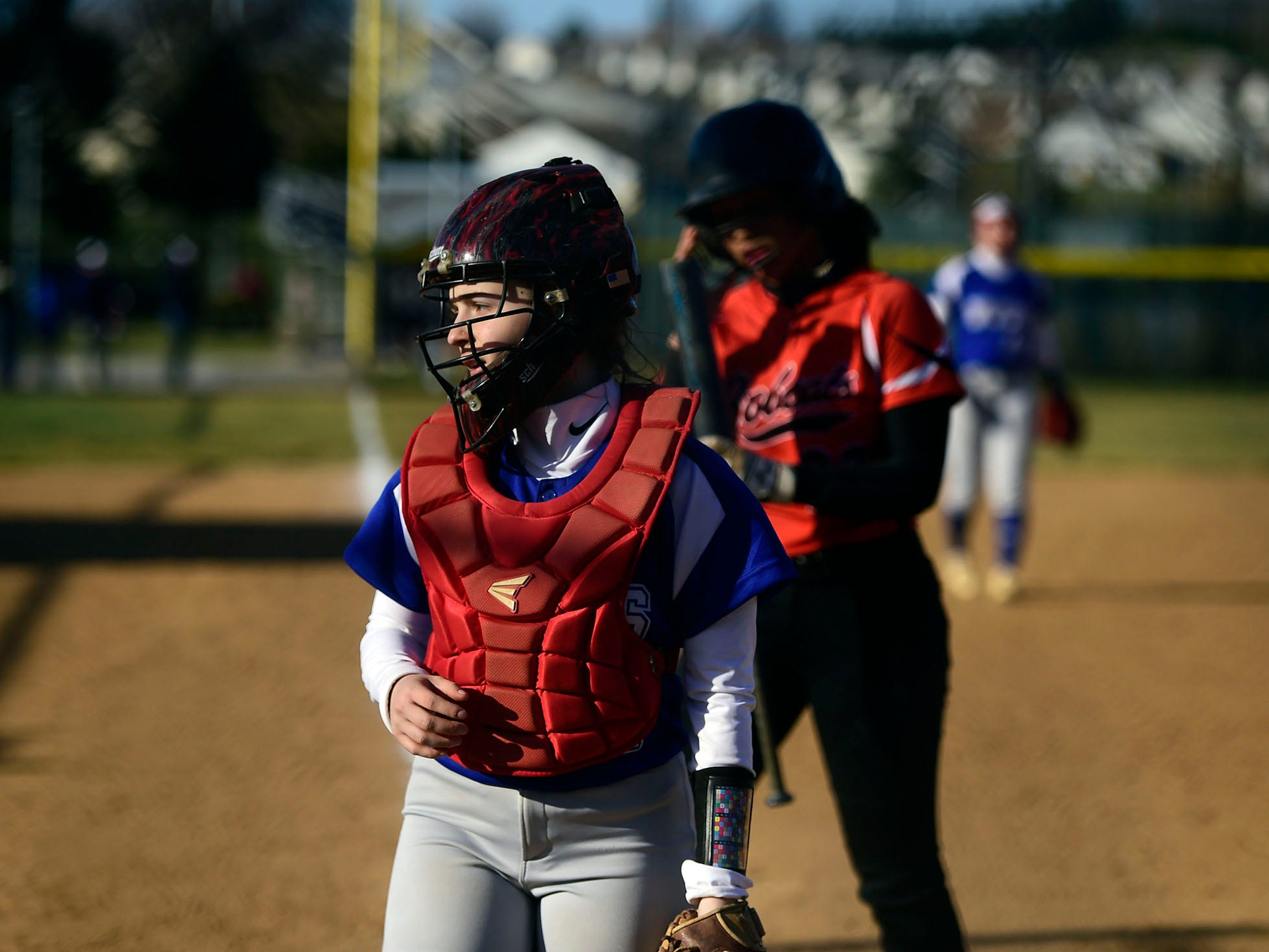 Spring Grove catcher Olivia Lillich watches a pop fly sail over the back stop during the Rockets' 19-14 victory against Northeastern Wednesday, April 3, 2019.