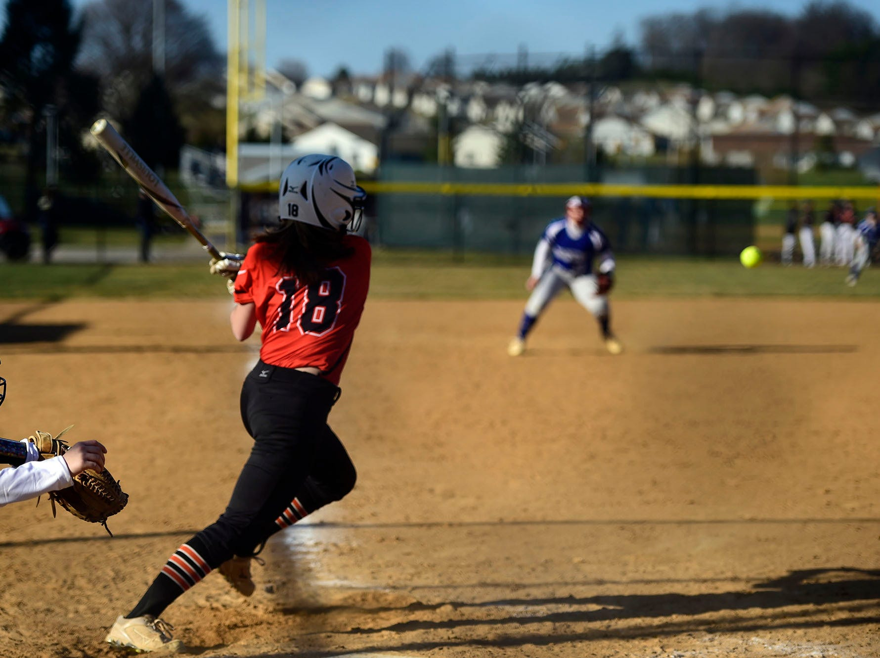 Northeastern's Peyton Eckenrode puts the ball in play on the left side of the infield Wednesday, April 3, 2019. Eckenrode went 3-for-4 with three runs scored and four RBIs during Spring Grove's 19-14 victory.