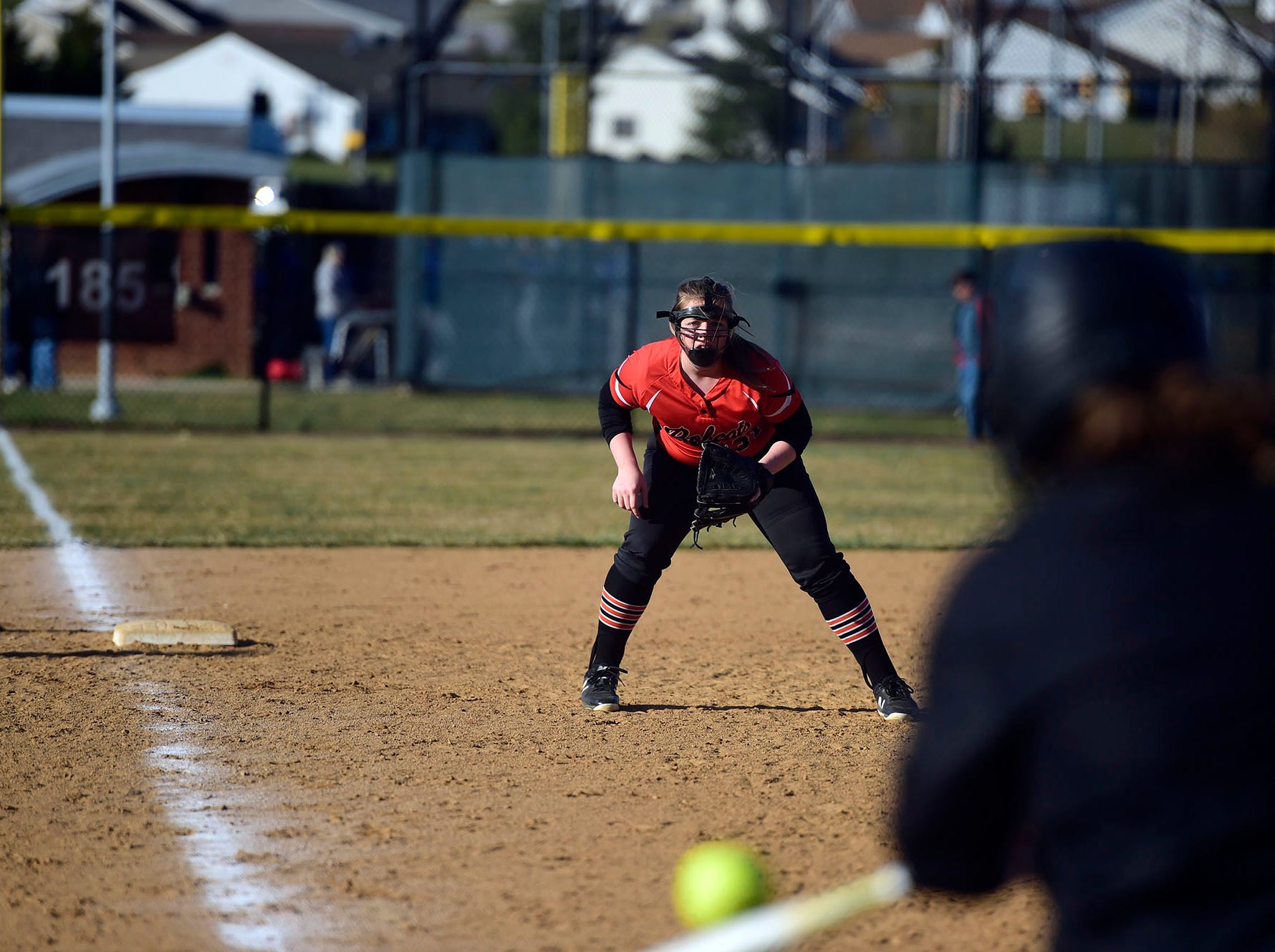 Northeastern third baseman Marissa Kipp stares down a Spring Grove hitter Wednesday, April 3, 2019.