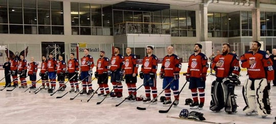 Members of the ROC Warriors hockey team comprised of military veterans from Rochester area stand for national anthem at a tournament in Alexandria, Virginia hosted by the Washington Capitals and laborer's union.