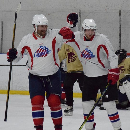 Jamie Bushart, left, and Shane LaDue of ROC Warriors White team celebrate a goal during men's league play at Paul Louis Arena. ROC Warriors field two teams in the league. Players find same sense of brotherhood on a hockey team as they felt in the military.