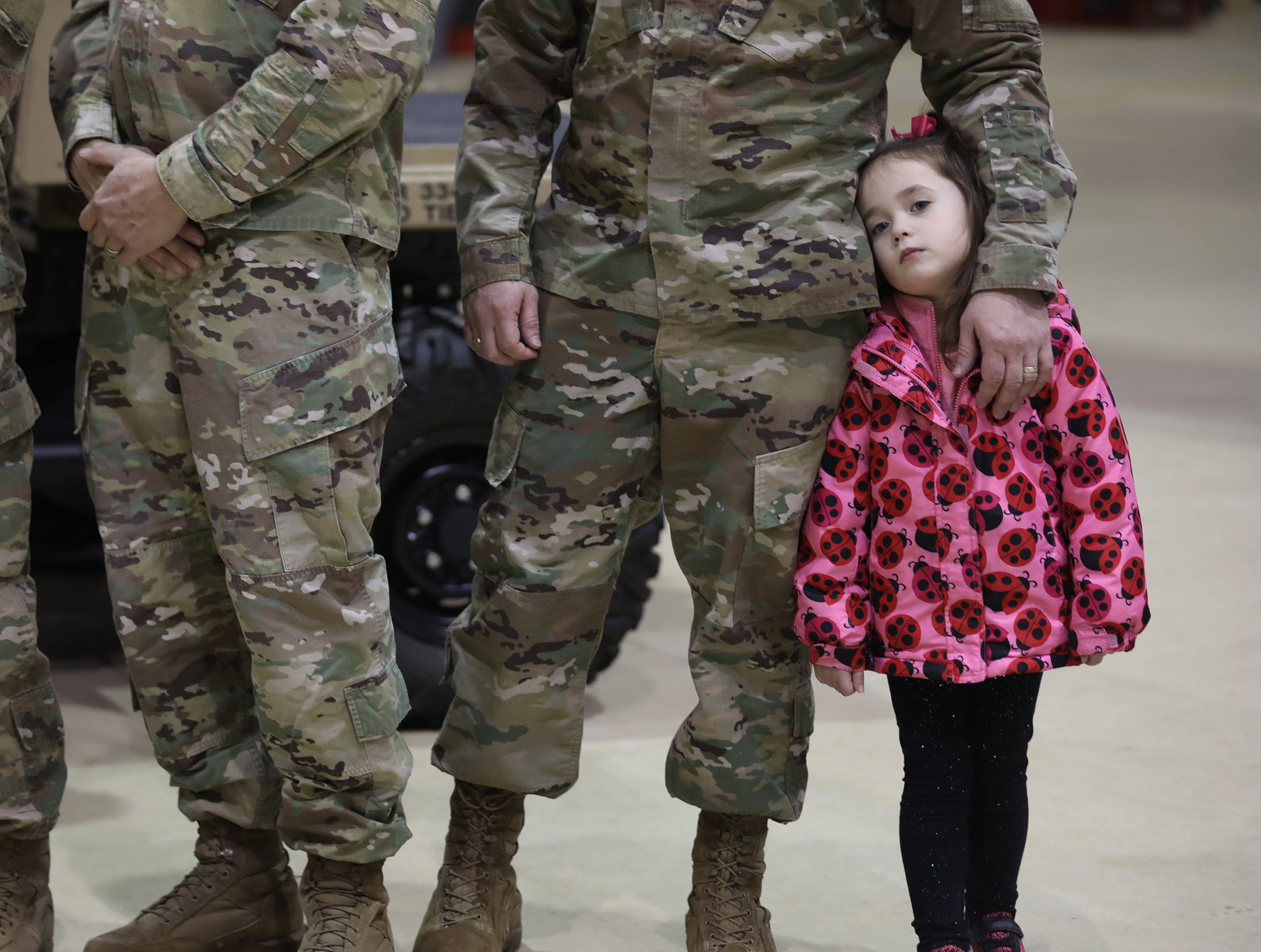 THE PHOTO:  Gov. Andrew Cuomo visits Rochester to talk about preparations in case of damage caused by strong winds expected in the area.  Kimley Maloney, 4, of Irondequoit, stands next to her father, U.S. Army Sgt. First Class Joe Maloney, as they wait for the governor's arrival for a press conference at the U.S. Army National Guard airport hangar.  FROM TINA:  I actually forgot to send this photo as a standalone (a slice of life image that runs without a story) that could be used in the paper if there's space.  I was running to the next assignment and it slipped my mind.  She caught my eye because of how she was always leaning into her father and the pink stool out against the camouflage.