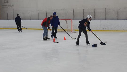 Veterans are taught hockey skills by volunteers with Amerks Alumni and OASIS Adaptive Sports at Paul Louis Arena. The 5-year-old program has graduated players into adult hockey league play.