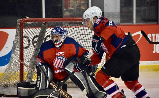 Goalie R.J. Sirianni and defenseman Brad Deule stand guard during Standing Warriors Tournament outside Washington, D.C. Many members of ROC Warriors learned to skate and play hockey through program operated by Amerks Alumni and OASIS Adaptive Sports at Paul Louis Arena.