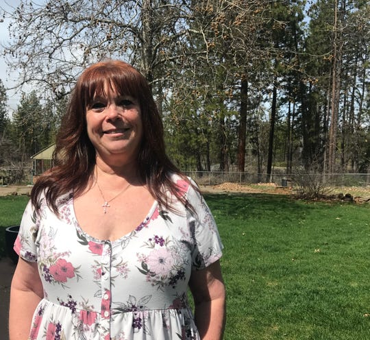 Tammy Allison poses near her family's business, Burney Transportation, in Johnson Park in this April 3, 2019 picture. Someone broke into the business recently and also has in the past, Allison said.