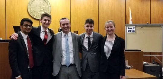 Left to right : Members of the Shasta High School mock trial team Ravi Patel of Redding, Drake Coy of Redding, consultant to the team and Redding attorney Joe Ahart, Jacob Patel of Redding and Shaina Dickie of Redding.