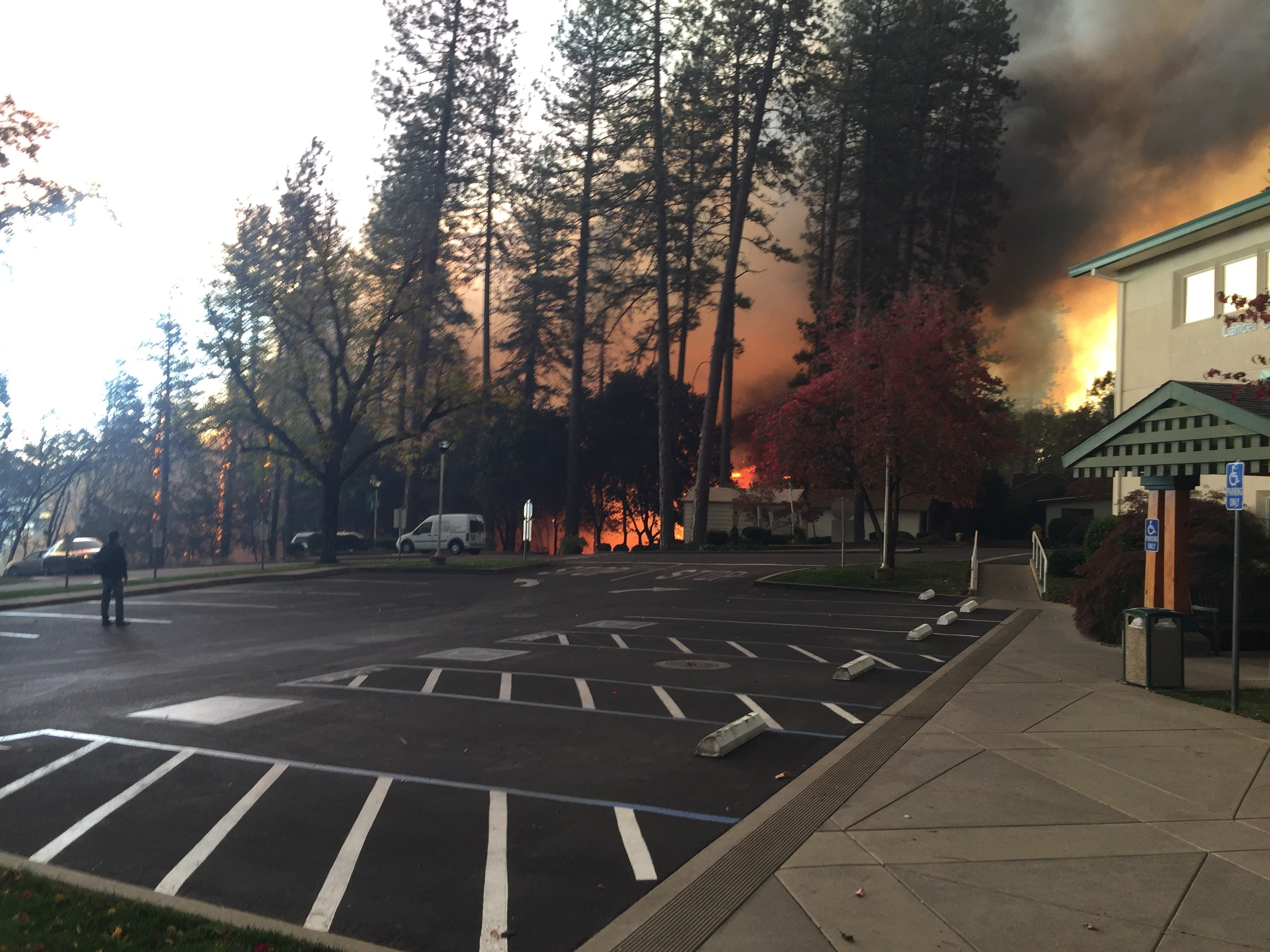 The Camp Fire is seen approaching Feather River Hospital in Paradise in November.