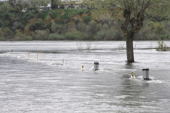 The Sacramento River rose Thursday, April 4, 2019, at the Marina RV Park after water releases went up to 30,000 cfs out of Keswick Dam. Electrical outlet boxes rise out of the water where about 12 RVs had to be moved to escape the rising river.