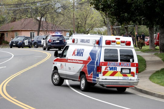 An ambulance and Redding police were at the corner of Canal Drive and South Street Thursday, April 4, 2019, where a resident killed himself inside a home from a self-inflicted gunshot wound.
