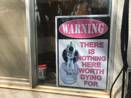 This sign sits in Lorraine Musholt's window in Johnson Park, where residents say crime is destroying their quality of life.