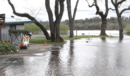 The Sacramento River was up Thursday, April 4, 2019, at the Marina RV Park after water releases increased to 30,000 cfs from Keswick Dam. About a dozen RVs had to be moved from the park's lower level to escape the rising river.