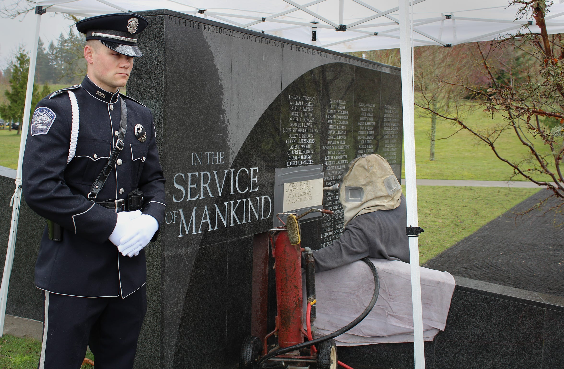 The City of Bend Police Department Honor Guard stands watch as the names of four officers are etched into the State's memorial at the Oregon Public Safety Academy in Salem April 3, 2019. The families of fallen officers and their names will be honored at the State's Fallen Officer Memorial ceremony later this year.