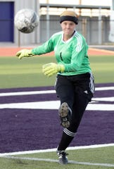 San Angelo Central keeper Megan White puts the ball in play during a Class 6A area soccer playoff against Odessa Permian at Abilene Wylie's Bulldog Stadium on Tuesday, April 2, 2019.