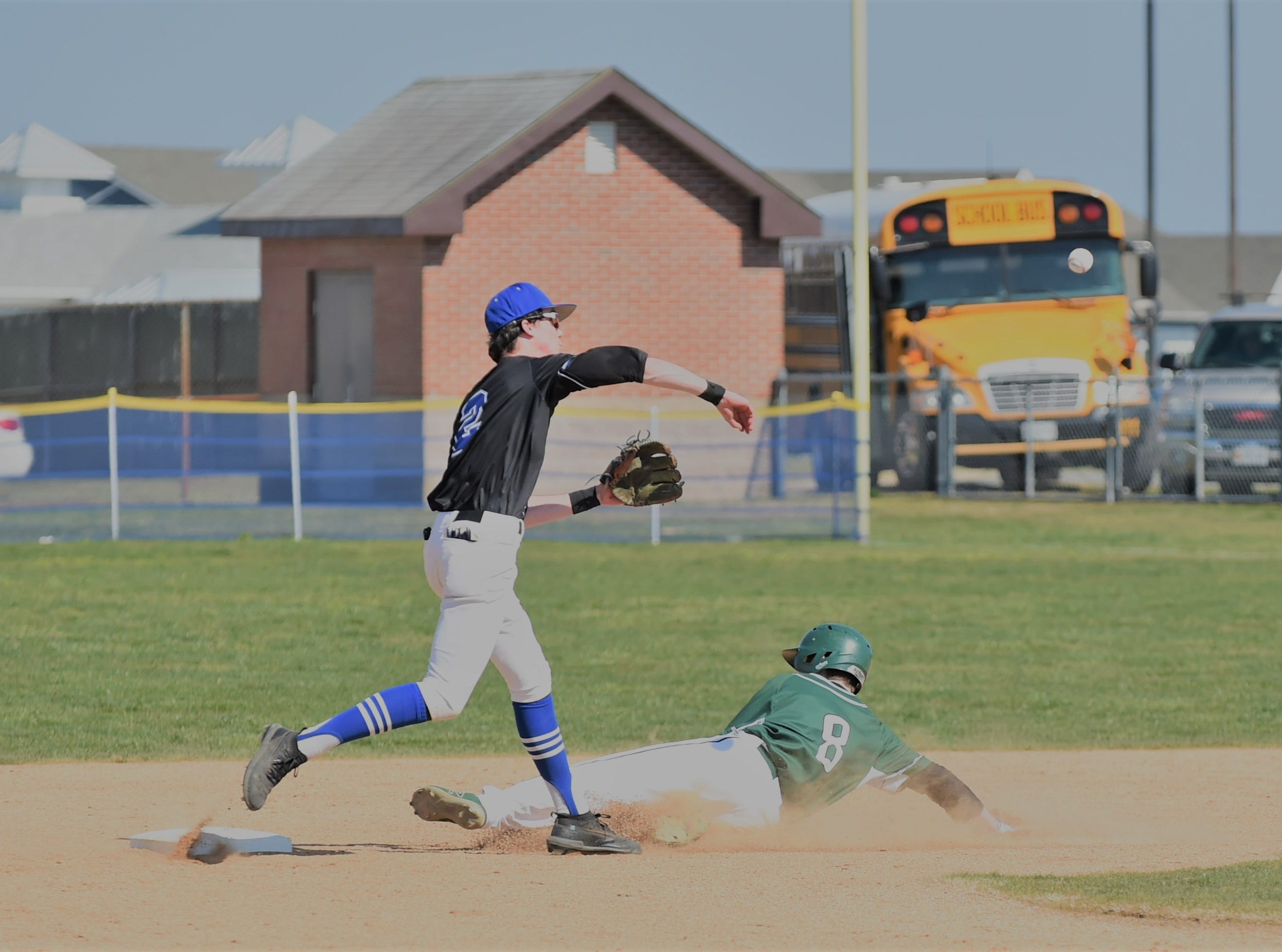 Stephen Decatur's Ridge Watson goes for the double play as Parkside's Brady Bailey slides into second on Wednesday, April 3, 2019.
