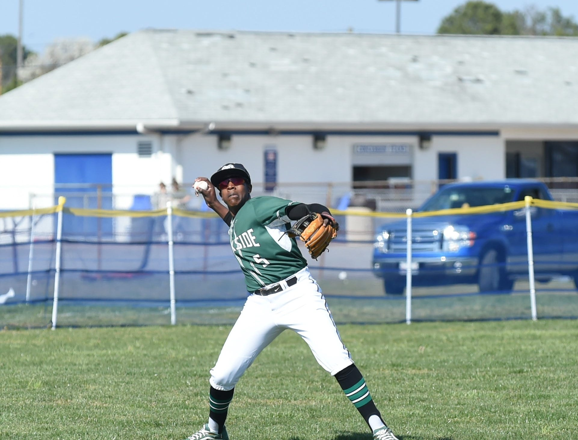 Parkside outfielder Ty'Rae Downing throws the ball in after catching a pop fly on Wednesday, April 3, 2019.