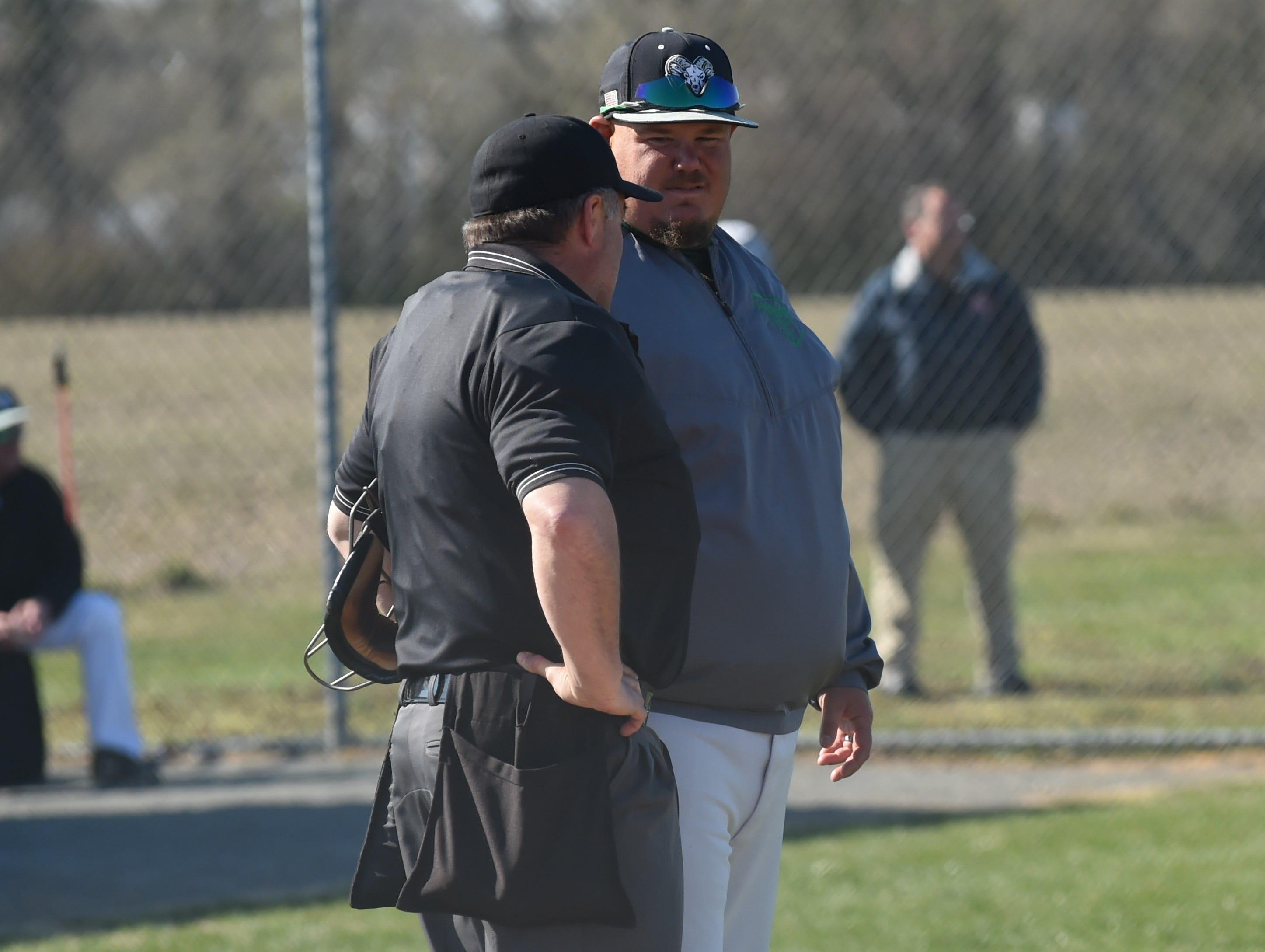 Parkside head coach Kyle Daubert speaks with an umpire on Wednesday, April 3, 2019.