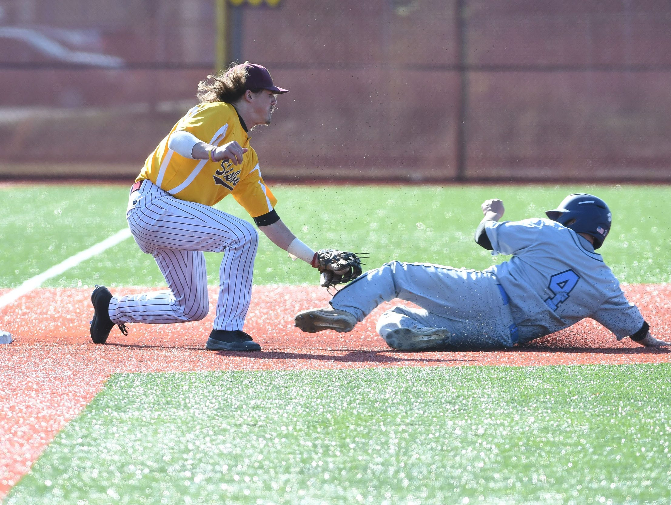 Salisbury University's Jimmy Adkins with the tag at third for the out against Wesley on Wednesday, April 3, 2019.