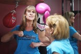 Instructor Lisa Howard talks about the Rock Steady Boxing class Wednesday, April 3, at The Inn on Westport in Sioux Falls.