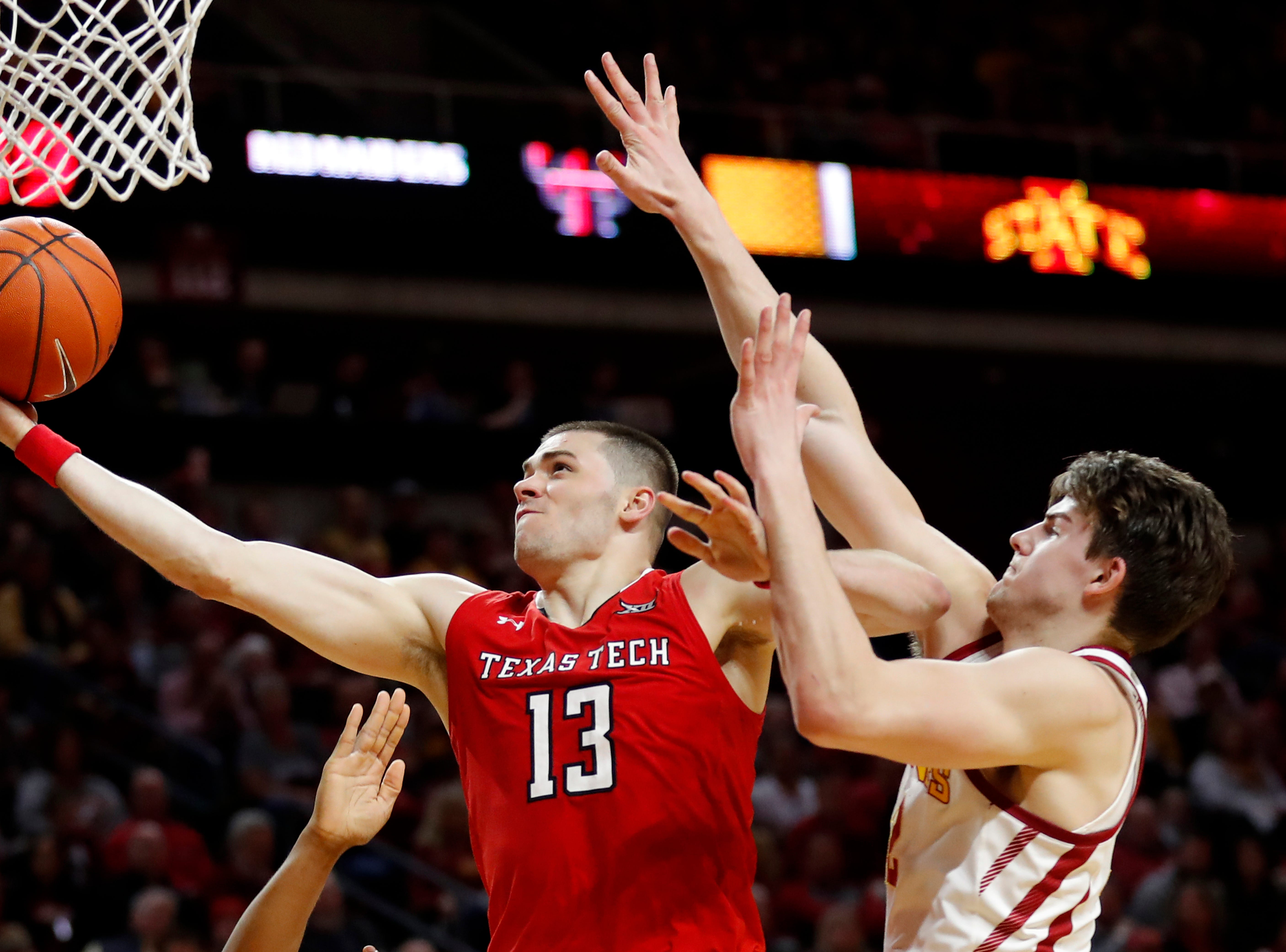 Texas Tech guard Matt Mooney (13) drives to the basket ahead of Iowa State forward Michael Jacobson during the second half of an NCAA college basketball game, Saturday, March 9, 2019, in Ames, Iowa. Texas Tech won 80-73. (AP Photo/Charlie Neibergall)