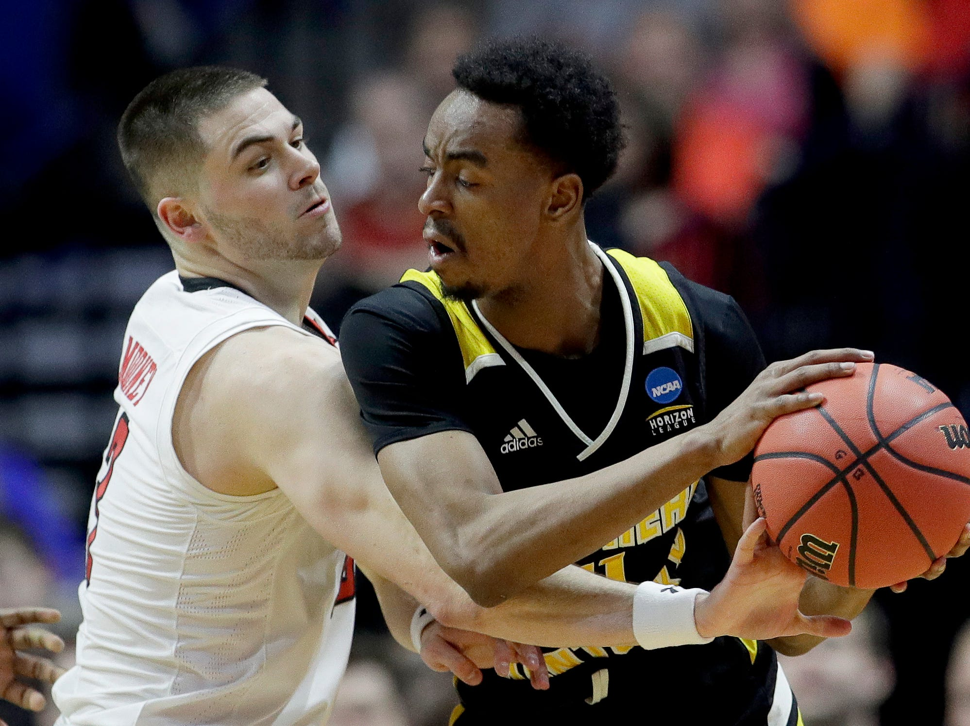 Texas Tech's Matt Mooney, left, tries to steal the ball from Northern Kentucky's Jalen Tate during the first half of a first round men's college basketball game in the NCAA Tournament Friday, March 22, 2019, in Tulsa, Okla. (AP Photo/Charlie Riedel)