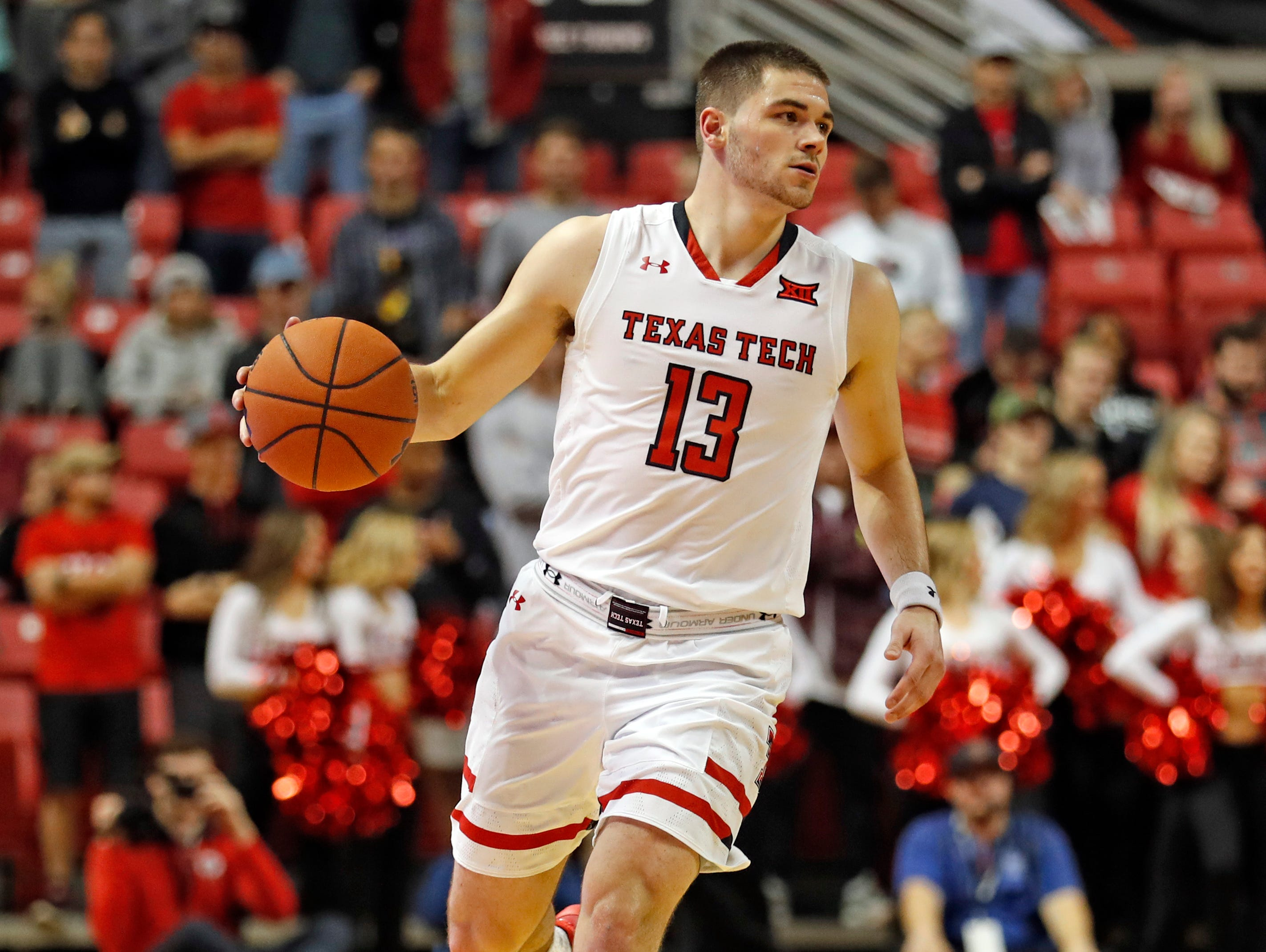 Texas Tech's Matt Mooney (13) dribbles the ball down the court during the second half of an NCAA college basketball game against Northwestern State, Wednesday, Dec. 12, 2018, in Lubbock, Texas. (AP Photo/Brad Tollefson)